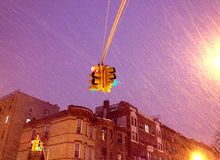 Snowstorm Purple Sky in New York City. View of street light during a New York City snowstorm with Instagram effect filter Royalty Free Stock Photography