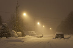 Snowstorm street. Picture of a calm and empty suburban street during a heavy snowfall. The picture was taken in the province of Quebec (Canada), at night time Royalty Free Stock Photography