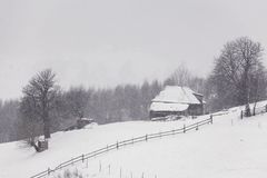 Snowstorm. Traditional household in the Romanian Carpathians during a snowstorm Royalty Free Stock Photo