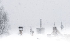 Snowstorm in village. Royalty Free Stock Photos