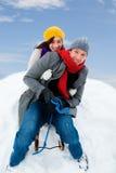 Snowwhite. Family sliding winter couple enjoying season Stock Photo
