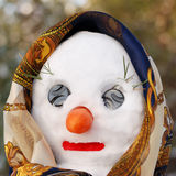 Snowwoman with hat, carrot nose Stock Images