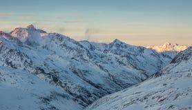 Snowy Альпы на сумраке Стоковое фото RF