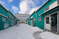 Snowy alley in Old Harbour area of Reykjavik. Old Harbour restaurants and shops along snowy alley in Reykjavik, Iceland Royalty Free Stock Photography