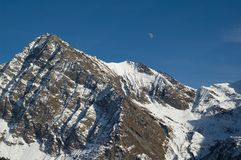 Snowy alpine mountains Stock Photography