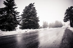 Snowy alpine road Royalty Free Stock Photos