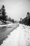 Snowy alpine road Royalty Free Stock Photo