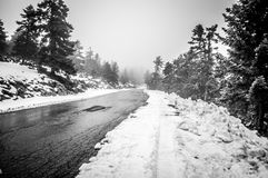 Snowy alpine road Royalty Free Stock Images