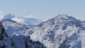 Snowy alpine summits in austria with clouds stock video