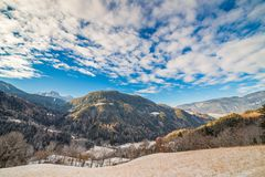 Snowy alpine valley. Panorama of snowy alpine valley Stock Photo