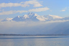 Snowy Alps and lake Maggiore Stock Photo