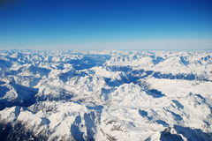 Snowy Alps in Switzerland. Captured from a plane Stock Photo