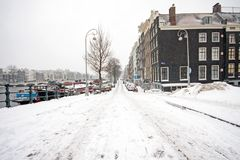 Snowy Amsterdam in Netherlands in winter Stock Images