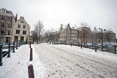 Snowy Amsterdam in the Netherlands. In winter Stock Photos