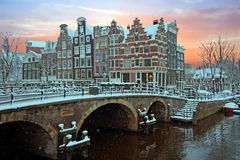 Snowy Amsterdam in the Netherlands in winter. At sunset Stock Images
