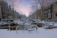 Snowy Amsterdam in the Netherlands in winter. At sunset Stock Photography