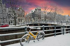 Snowy Amsterdam in the Netherlands in winter. At sunset Royalty Free Stock Photography