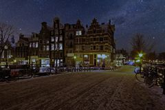 Snowy Amsterdam by night in Netherlands. Snowy Amsterdam by night in the Netherlands Royalty Free Stock Photos