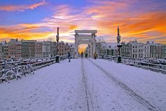 Snowy Amsterdam with the Thiny bridge in the Netherlands Stock Images