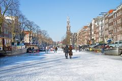 Snowy Amsterdam with the Westerkerk in the Netherlands. In winter Royalty Free Stock Images