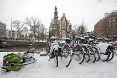 Snowy Amsterdam with the Westerkerk in the Netherlands. In winter Stock Images