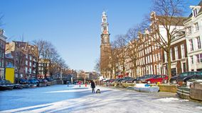 Snowy Amsterdam in the Netherlands in winter. Snowy Amsterdam with the Westerkerk in the Netherlands in winter Royalty Free Stock Photo