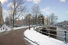 Snowy Amsterdam in winter in Netherlands. Snowy Amsterdam in winter in the Netherlands Royalty Free Stock Images