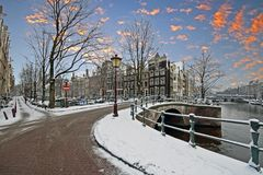 Snowy Amsterdam in winter in the Netherlands. At sunrise Royalty Free Stock Photo