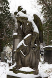 Snowy Angel from the mystery old Prague Cemetery, Czech Republic Stock Photo
