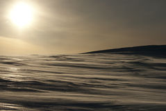 Snowy Antarctic desert backlit Antarctic winter. Royalty Free Stock Photos