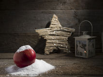 Snowy apple with christmas lamp decorated Royalty Free Stock Photo