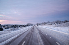 Snowy asphalt country road Stock Image