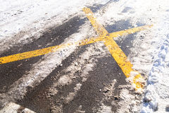 Snowy asphalt roadside cross Royalty Free Stock Photography