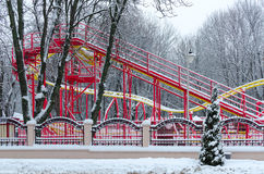 Snowy attraction Funny roller coaster in winter park during snow Stock Photos
