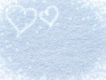 Snowy background with hearts for Valentine`s day stock photo