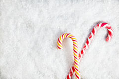 Snowy Background With Two Candy Canes Stock Photos
