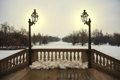Snowy balcony. A snowy luxury balcony illuminated by two beautiful old lights, Monza, Italy royalty free stock photo