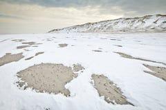 Snowy beach. And dunes on the island Vlieland, The Netherlands Stock Photo