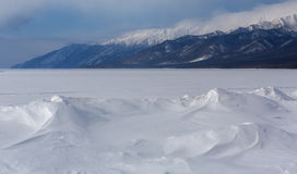 Snowy Beach of Lake Baikal and Holy Nose Peninsula. Stock Photo