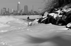 The Snowy Beach and Skyline of Downtown Cleveland Ohio Stock Photos