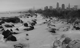 The Snowy Beach and Skyline of Downtown Cleveland Ohio Stock Photography