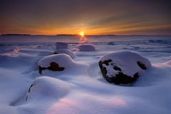 Snowy beach sunrise Stock Photo