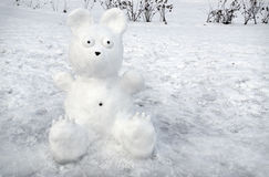 Snowy bear on background of snow Royalty Free Stock Photography
