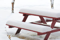 Snowy bench Royalty Free Stock Photo
