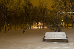 Snowy bench in the park Stock Image