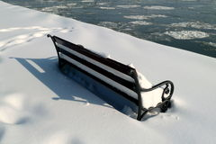 Snowy bench and shadow Royalty Free Stock Image