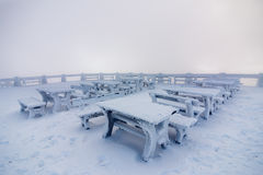 Snowy bench in winter Stock Photos
