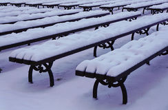 Snowy benches in city park Stock Image