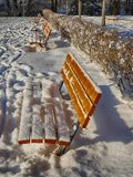 Snowy benches in park Royalty Free Stock Photos