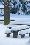 Snowy benches. White benches, winter landscape, pile of snow royalty free stock photo